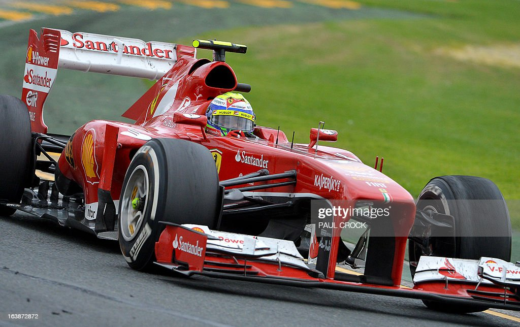 Ferrari driver Felipe Massa of Brazil powers through a corner during the Formula One Australian Grand Prix in Melbourne on March 17, 2013. IMAGE RESTRICTED TO EDITORIAL USE - STRICTLY NO COMMERCIAL USE AFP PHOTO / Paul CROCK