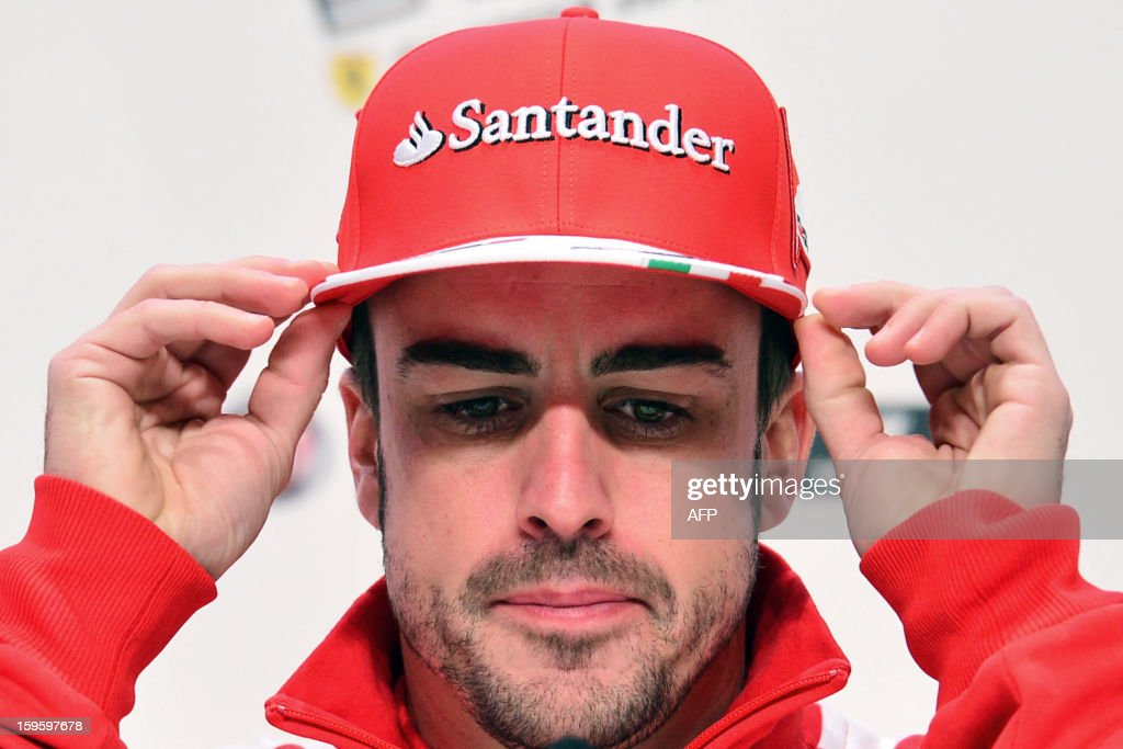 Ferrari driver Fernando Alonso adjusts his cap during a press conference during the Wrooom, F1 and MotoGP Press Ski Meeting, Ducati and Ferrari's annual media gathering, in Madonna di Campiglio on January 17, 2013.