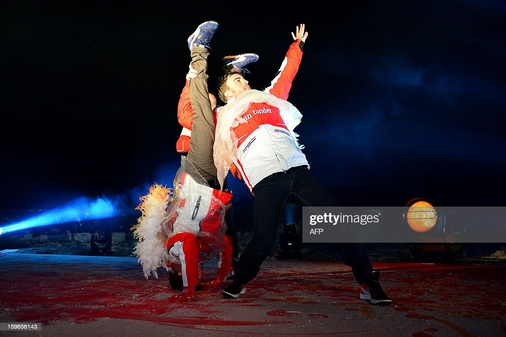 Ferrari driver Fernando Alonso (R) and Ducati Driver Nicky Hayden perform on stage during a show at the Wrooom, F1 and MotoGP press ski meeting, Ducati and Ferrari's annual media gathering on January 17, 2013 in Madonna di Campiglio. AFP PHOTO / GIUSEPPE CACACE