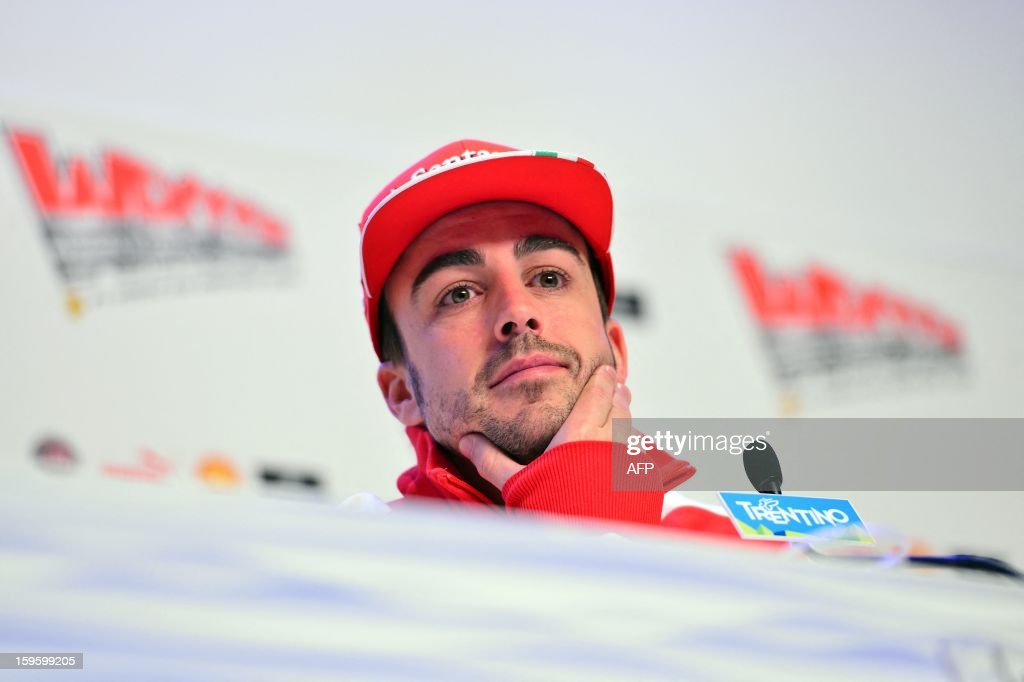 Ferrari driver Fernando Alonso looks on during a press conference during the Wrooom, F1 and MotoGP Press Ski Meeting, Ducati and Ferrari's annual media gathering, in Madonna di Campiglio on January 17, 2013.