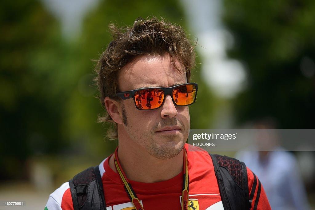 Ferrari driver Fernando Alonso of Spain arrives in the paddock ahead of the Formula One Malaysian Grand Prix at the Sepang circuit near Kuala Lumpur...
