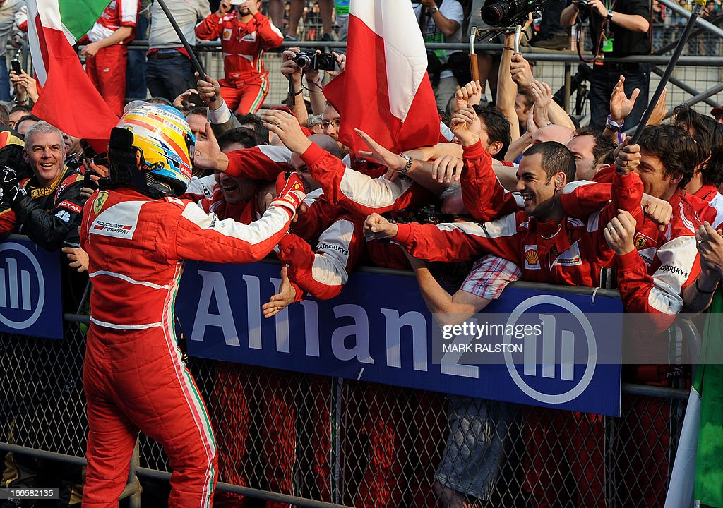 Ferrari driver Fernando Alonso of Spain celebrates with his team after winning the Formula One Chinese Grand Prix in Shanghai on April 14 2013 AFP...