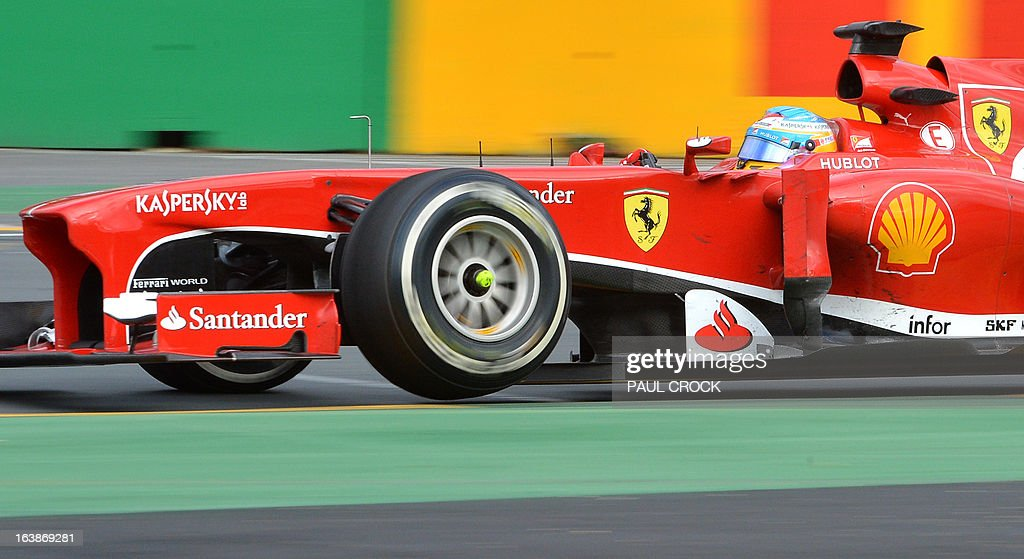 Ferrari driver Fernando Alonso of Spain powers through a corner on his way to second place in the Formula One Australian Grand Prix in Melbourne on March 17, 2013. IMAGE RESTRICTED TO EDITORIAL USE - STRICTLY NO COMMERCIAL USE AFP PHOTO / Paul CROCK