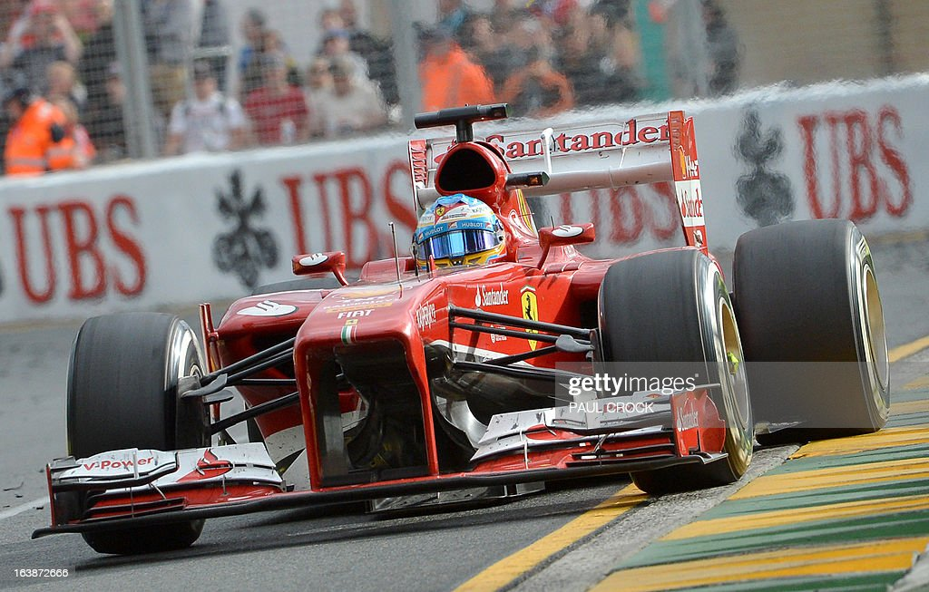 Ferrari driver Fernando Alonso of Spain powers through a corner on his way to winning second place in the Formula One Australian Grand Prix in Melbourne on March 17, 2013. IMAGE RESTRICTED TO EDITORIAL USE - STRICTLY NO COMMERCIAL USE AFP PHOTO / Paul CROCK