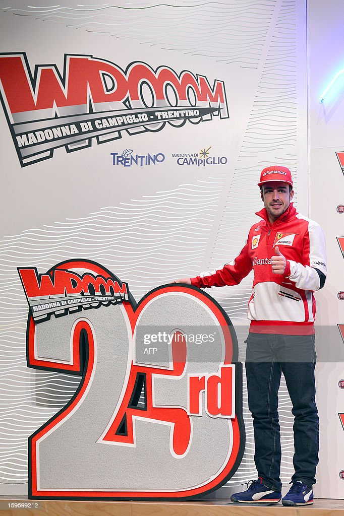 Ferrari driver Fernando Alonso poses at the end of a press conference during the Wrooom, F1 and MotoGP Press Ski Meeting, Ducati and Ferrari's annual media gathering, in Madonna di Campiglio on January 17, 2013.
