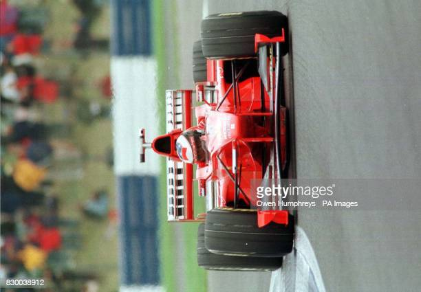 Ferrari driver Michael Schumacher accelerates out of the club corner today took pole position for the British Grand Prix at Silverstone Photo by Owen...