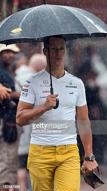 Ferrari driver Michael Schumacher of germany arrives at the paddock for his practice session of Formula One's Singapore Grand Prix in Singapore on...