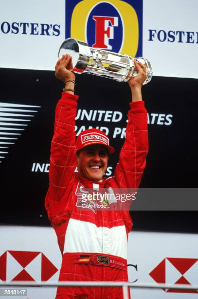 Ferrari driver Michael Schumacher of Germany celebrates victory on the podium during the United States Formula One Grand Prix held on September 28...