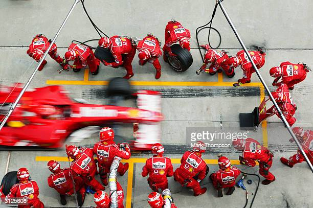 Ferrari driver Michael Schumacher of Germany comes in for a pitstop during the 2004 F1 Malaysian Grand Prix held on March 21 2004 at the Sepang...