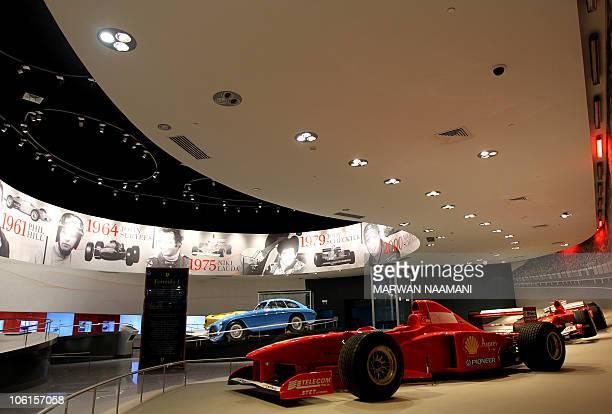 Ferrari F1 cars are seen inside the 'Hall of Fame' of the Ferrari theme park in the Emirati capital of Abu Dhabi on October 26 2010 'Ferrari World...