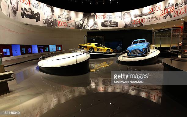 Ferrari F1 cars are seen inside the 'Hall of Fame' of the Ferrari theme park in the Emirati capital of Abu Dhabi on October 26 2010 'Ferrari World...
