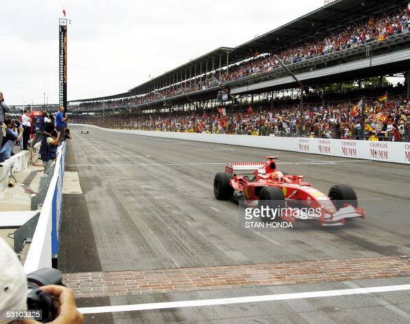 Ferrari F1 driver Michael Schumacher of Germany approaches the finish line as he wins the Formula One US Grand Prix 19 June 2005 at the Indianapolis...