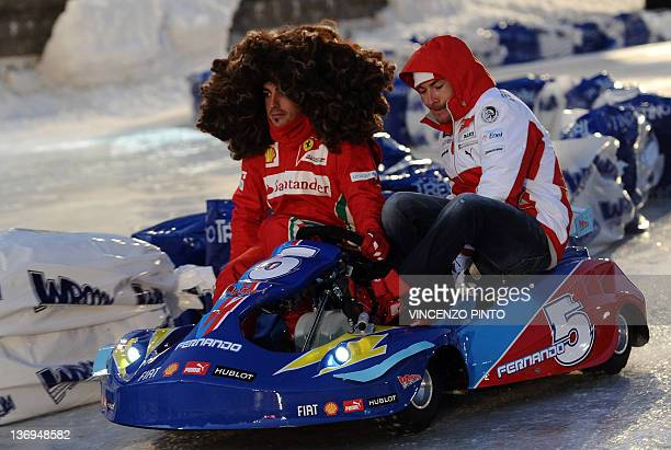 Ferrari F1 Spanish driver Fernando Alonso wearing a wig and Ducati US rider Niki Hayden drive a kart prior to a race on January 13 2012 as part of...