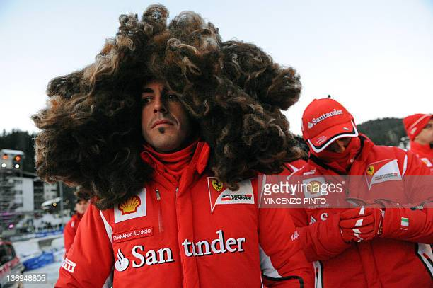 Ferrari F1 Spanish driver Fernando Alonso wearing a wig arrives with team mate Brazilian Felipe Massa for a kart race on January 13 as part of the...