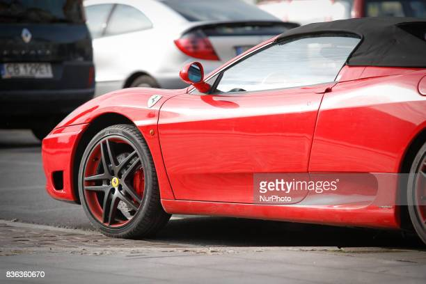 A Ferrari F430 is seen in the old center of the city on 19 August 2017