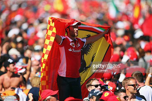 Ferrari fan celebrates on the pit straight after the Formula One Grand Prix of Italy at Autodromo di Monza on September 6 2015 in Monza Italy