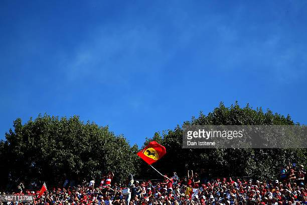Ferrari fan hods a flag aloft before the Formula One Grand Prix of Italy at Autodromo di Monza on September 6 2015 in Monza Italy