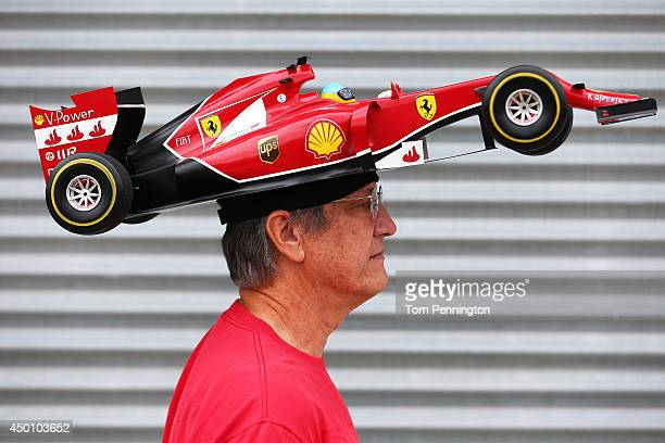 Ferrari Fan Kim Reiner walks through the paddock ahead of the Canadian Formula One Grand Prix at Circuit Gilles Villeneuve on June 5 2014 in Montreal...