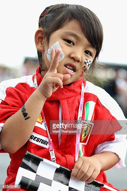Ferrari fan poses for a photo in the fan zone before the Formula One Grand Prix of Japan at Suzuka Circuit on October 9 2016 in Suzuka