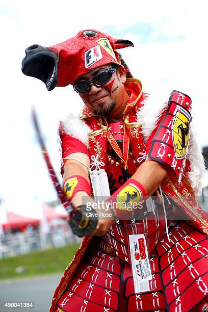 Ferrari fan poses outside the circuit before final practice for the Formula One Grand Prix of Japan at Suzuka Circuit on September 26 2015 in Suzuka
