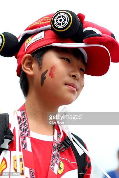 Ferrari fan poses outside the circuit before the Formula One Grand Prix of Japan at Suzuka Circuit on September 27 2015 in Suzuka Japan