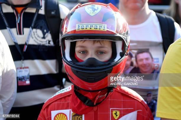 A Ferrari fan walks in the paddock at the Sochi Autodrom circuit in Sochi on April 27 2017 The Formula One Russian Grand Prix will take place on...