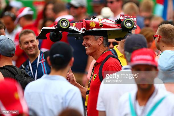 Ferrari fan walks in the pit lane after the Formula One Grand Prix of Italy at Autodromo di Monza on September 4 2016 in Monza Italy