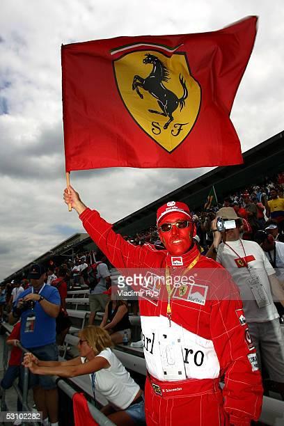 Ferrari fan waves a Ferrari flag before the US F1 Grand Prix on June 19 2005 in Indianapolis Indiana
