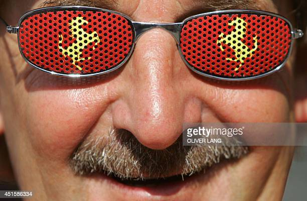 A Ferrari fan wears glasses with the logo of his favourite racing stable prior to the Grand Prix of Germany Formula One race in Hockenheim on 24 July...