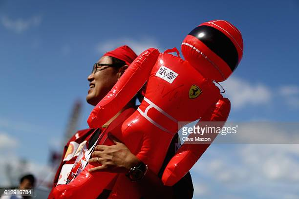 Ferrari fan with a blow up driver during previews ahead of the Formula One Grand Prix of Japan at Suzuka Circuit on October 6 2016 in Suzuka