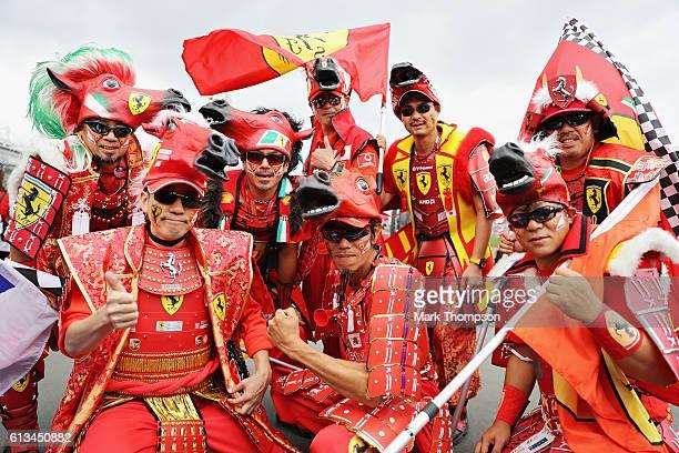 Ferrari fans dressed as Samurai in the fan zone before the Formula One Grand Prix of Japan at Suzuka Circuit on October 9 2016 in Suzuka