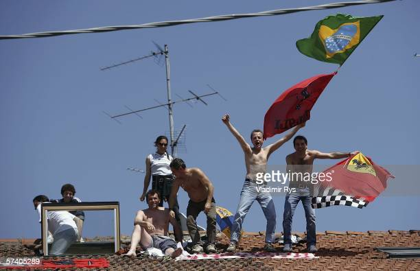 Ferrari fans stand on a roof of a family house during the San Marino Formula One Grand Prix at the San Marino Circuit on April 23 in Imola Italy
