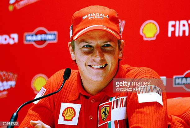 Ferrari Formula One driver Finland's Kimi Raikkonen poses for the first time with Ferrari's colors during the 'WROOOM F1 press meeting' the yearly...
