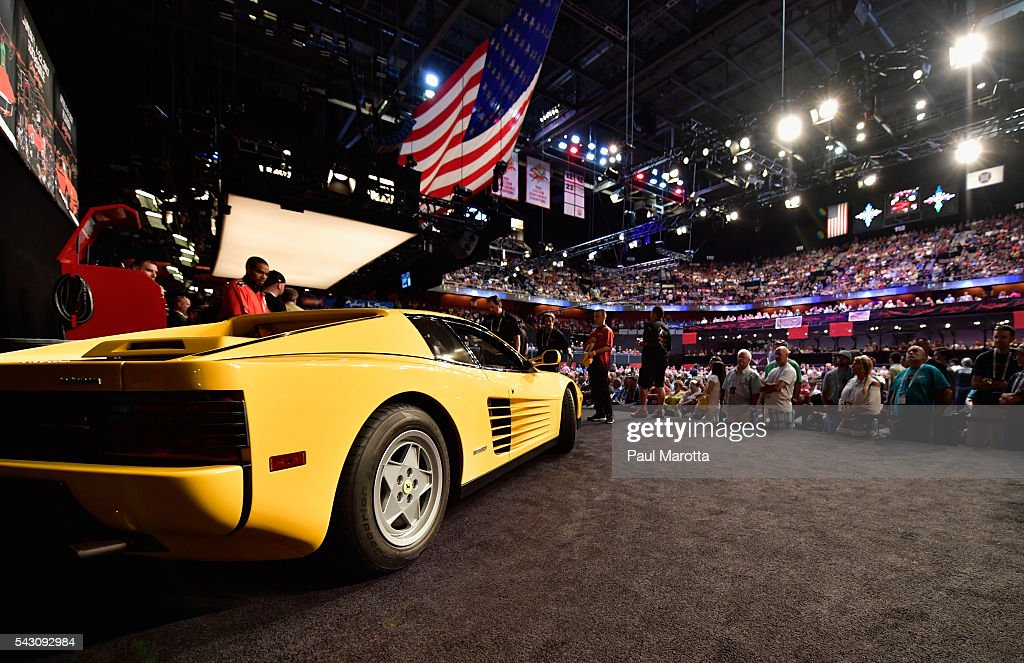 A Ferrari is auctioned at the Barrett-Jackson Inaugural Northeast Auction at Mohegan Sun Arena on June 25, 2016 in Uncasville, Connecticut. Organizers estimated app. 70,000 vistors attended the three day auction June 23-25 during which hundreds of collectors were sold at auction.