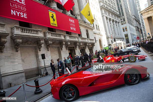 Ferrari is parked outside the New York Stock Exchange in celebration of Ferrari Automotive Company's IPO on October 21 2015 in New York City Ferrari...