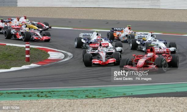 Ferrari Kimi Raikkonen and McLaren's Fernando Alonso at the start of the the European Formula One Grand Prix at the Nurburgring Germany