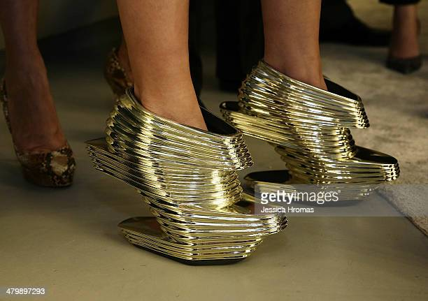 Ferrari Koolhaas is wearing Zaha Hadid designed shoes at the opening of the Stuart Weitzman Boutique which was designed by Zaha Hadid in the IFC Mall...