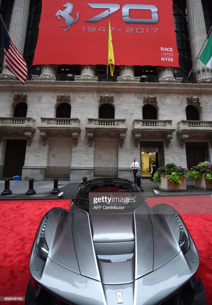 A Ferrari LaFerrari Aperta is seen in front of the NYSE after Ferrari N.V. led by Chairman Sergio Marchionne and members of the companys leadership team ring the opening bell at the New York Stock Exchange October 9, 2017 to commemorate the companys 70th anniversary. /