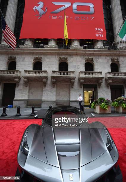 A Ferrari LaFerrari Aperta is seen in front of the NYSE after Ferrari NV led by Chairman Sergio Marchionne and members of the companys leadership...