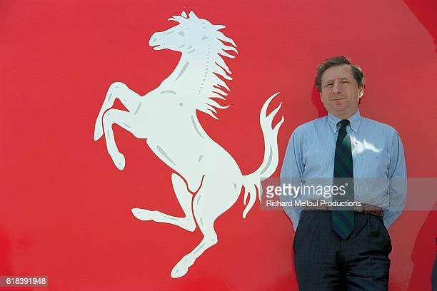 Ferrari Managing Director Jean Todt gives a guided tour behind the scenes at the Ferrari production factory Todt in front of the Ferrari logo