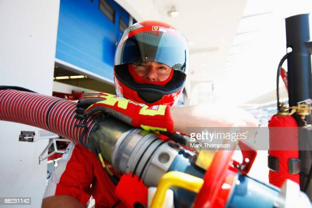 Ferrari mechanic waits for one of their cars to come in for refuelling during practice for the Turkish Formula One Grand Prix at Istanbul Park on...