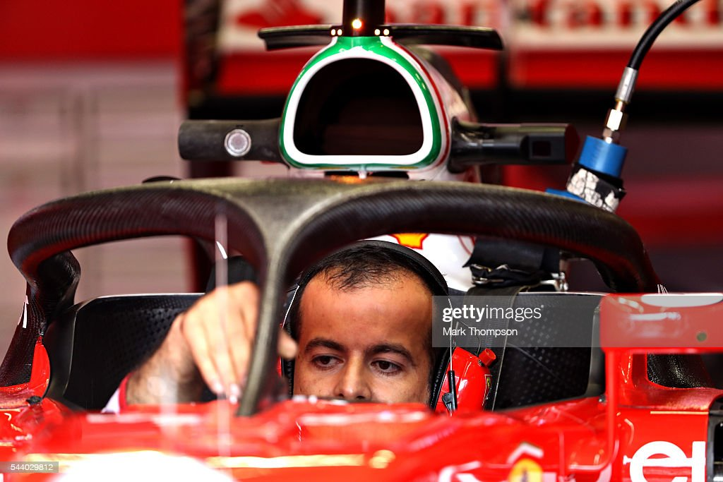 A Ferrari mechanic works on the car fitted with the halo in the garage before practice for the Formula One Grand Prix of Austria at Red Bull Ring on July 1, 2016 in Spielberg, Austria.
