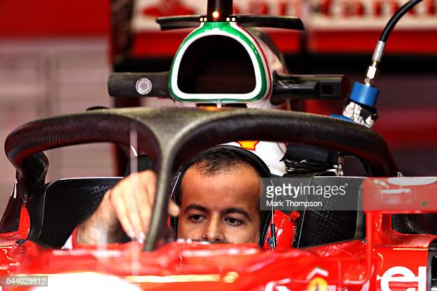 Ferrari mechanic works on the car fitted with the halo in the garage before practice for the Formula One Grand Prix of Austria at Red Bull Ring on...