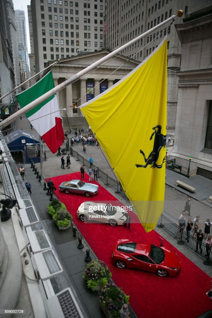 Ferrari models are lined up in front of the New York Stock Exchange on October 9, 2017 in New York City. Ferrari Chairman Sergio Marchionne rang the stock exchange's opening bell, commemorating the company's 70th anniversary.