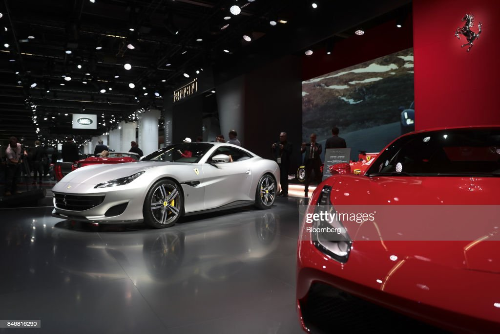 A Ferrari NV Portofino entry-level supercar, left, stands beside a Ferrari 488 luxury automobile during the second media preview day of the IAA Frankfurt Motor Show in Frankfurt, Germany, on Wednesday, Sept. 13, 2017. The 67th IAA opens to the public on Sept. 14 and features must-have vehicles and motoring technology from over 1,000 exhibitors in a space equivalent to 33 soccer fields. Photographer: Simon Dawson/Bloomberg via Getty Images