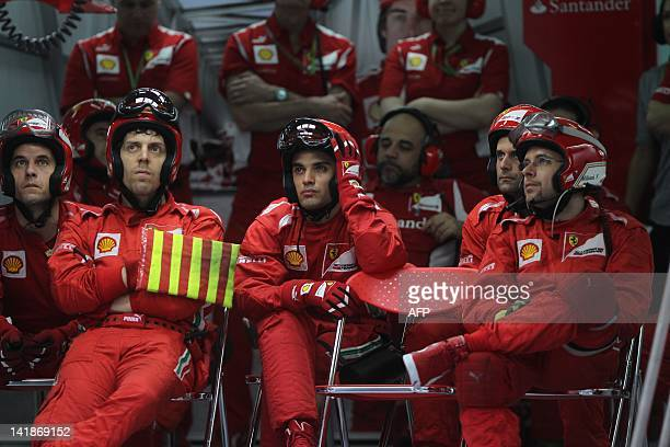 Ferrari pit crew members monitor the screen during Formula One's Malaysian Grand Prix at the Sepang International Circuit in Sepang on March 25 2012...