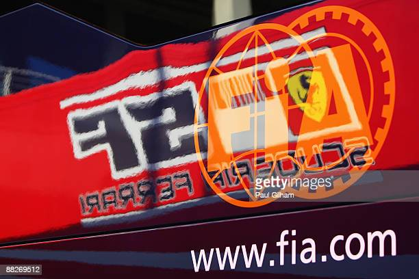 Ferrari Prancing Horse logo is seen reflected in the side of the FIA motorhome following qualifying for the Turkish Formula One Grand Prix at...