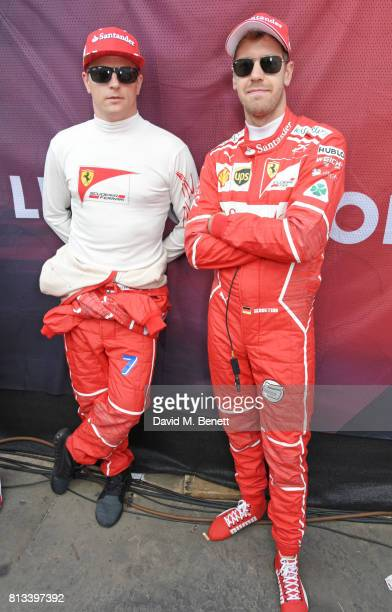 Ferrari racing drivers Kimi Raikkonen and Sebastian Vettel pose backstage at F1 Live London at Trafalgar Square on July 12 2017 in London England F1...