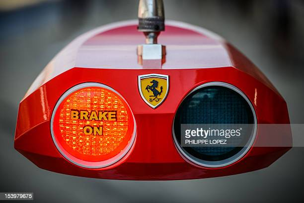 A Ferrari red light indicator is seen in the pit lane during the second practice session of the Formula One Korean Grand Prix at the Korean Circuit...