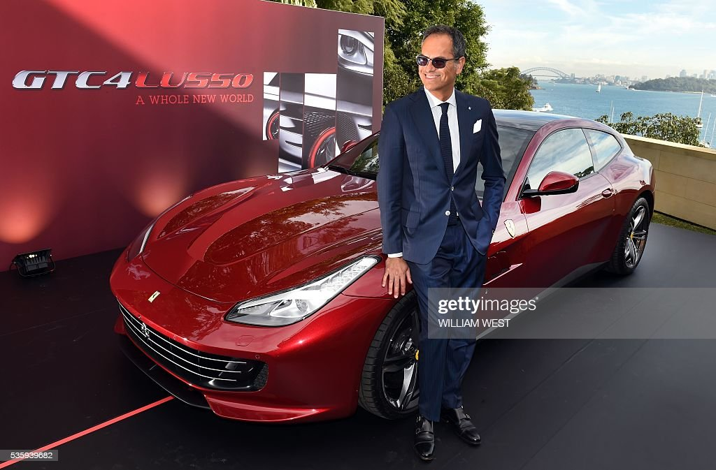 Ferrari Senior Vice President of Design Flavio Manzoni poses with the new Ferrari GTC4Lusso during the car's Australasian launch in Sydney on May 31, 2016. WEST